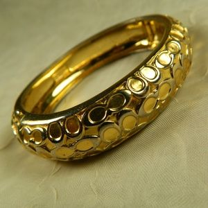 Gold tone Coach Insignia Bangle Bracelet